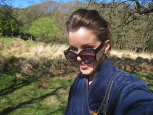tramping around the Irish countryside, naked under a bathrobe