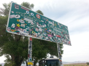 "sign marking the ""Extraterrestrial Highway,"" now covered in stickers"