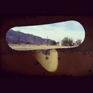 view from the rear window of an old Airstream