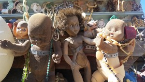 Sunbaked dolls on an art car in Goldfield